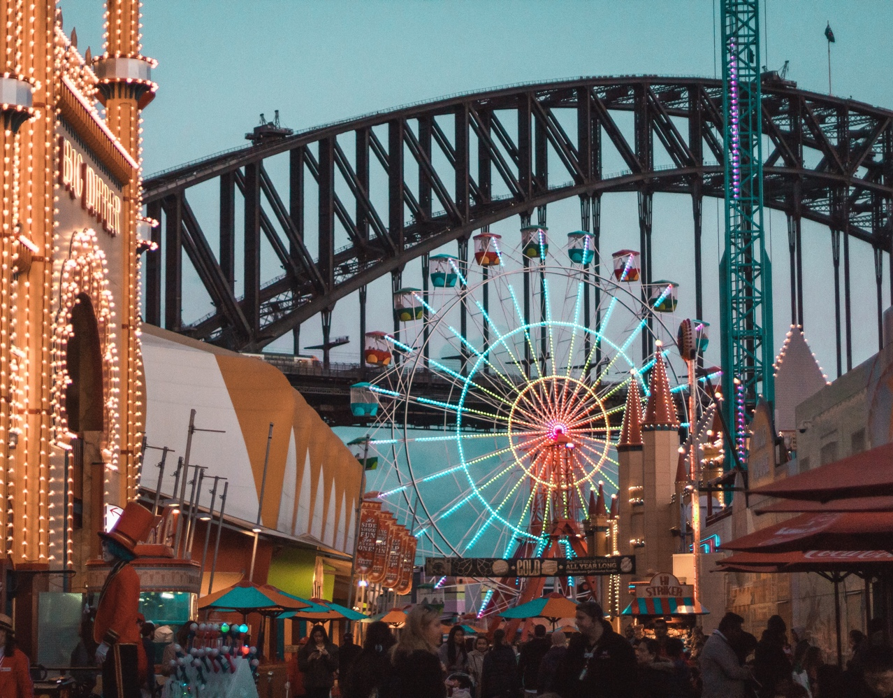 Busy street view of Sydney with Carousel and bridge in the background