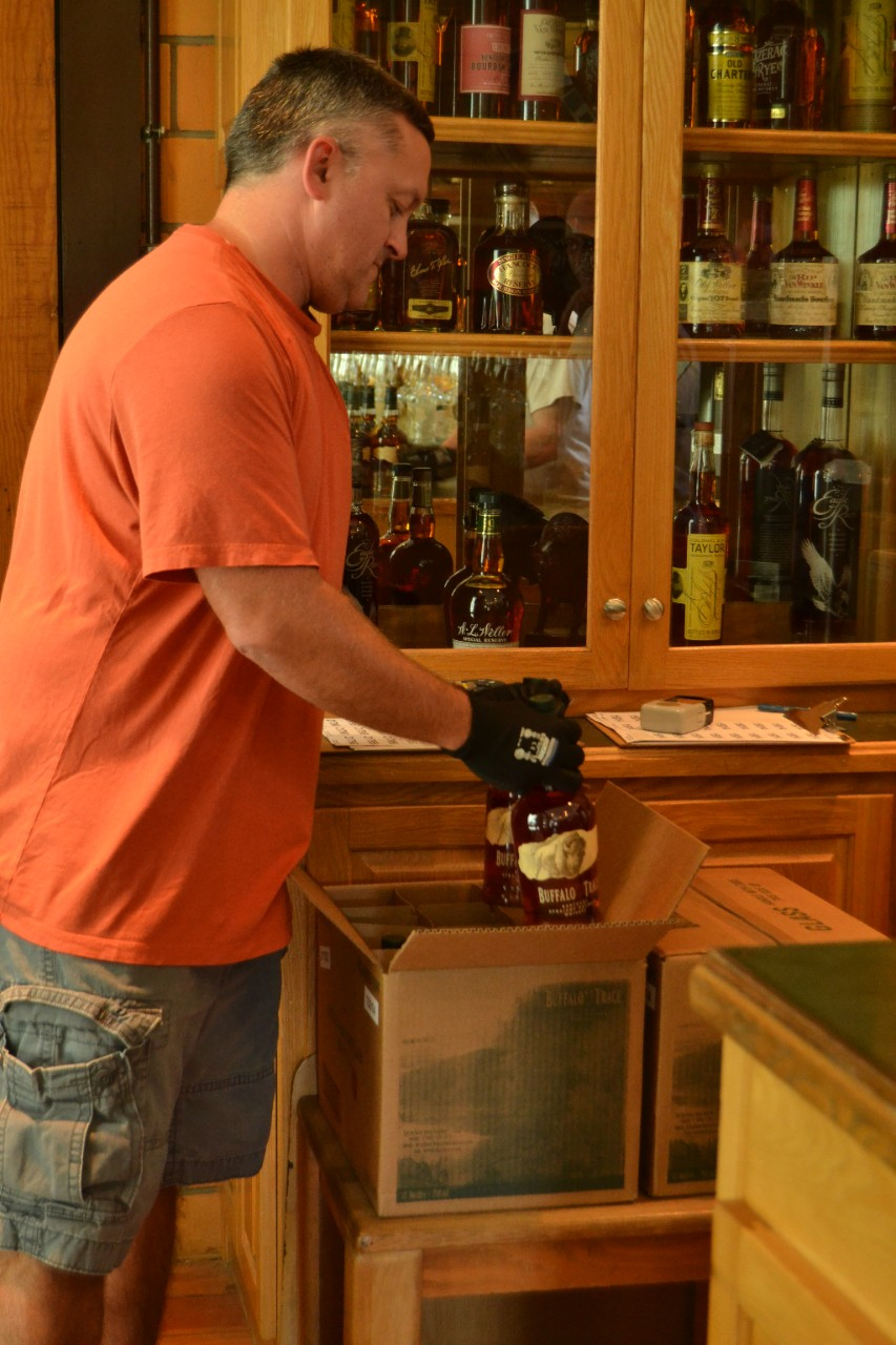 Man putting bottles of Buffalo Trace in a box