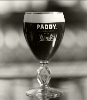 Black and white closeup of Irish Coffee in Paddy glass