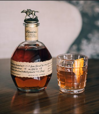 Blanton's bourbon bottle and old fashioned in glass