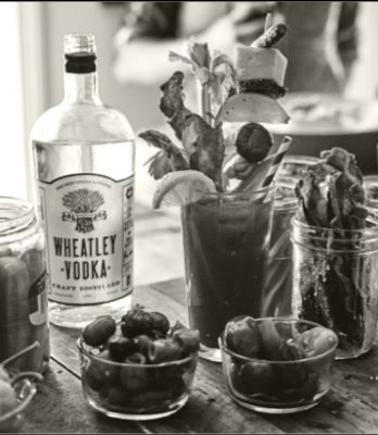 Black and white Wheatley vodka bottle and bloody mary with garnish