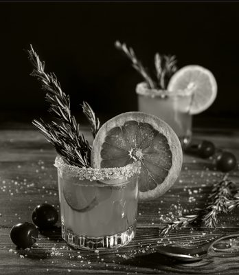 Black and white cocktail with grapefruit rim and garnish
