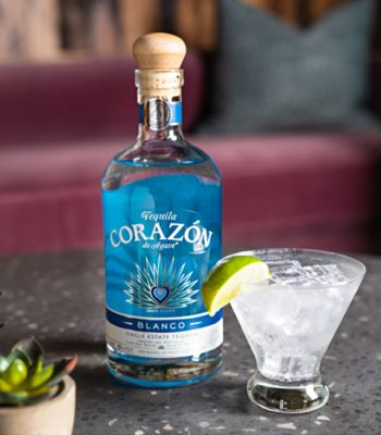 Corazon Blanco Tequila Bottle and cocktail on table