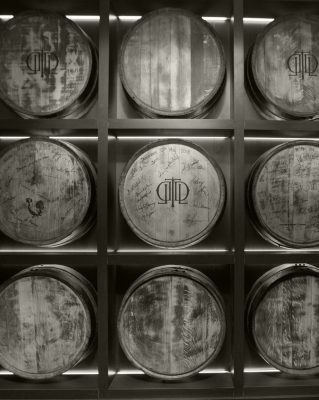 Download Black and white wall of Last Drop barrels