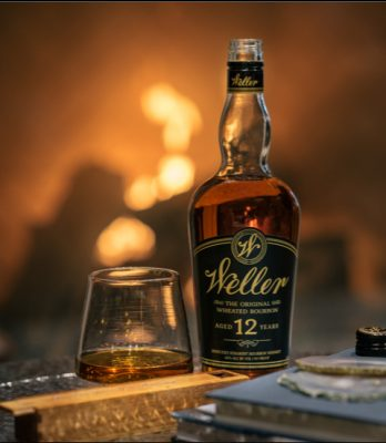 Download Neat pour of Weller and Weller bottle with fire in background