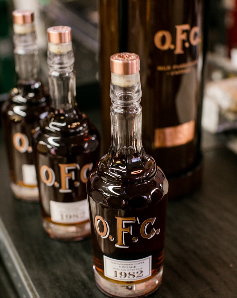 Three OFC bottles on table