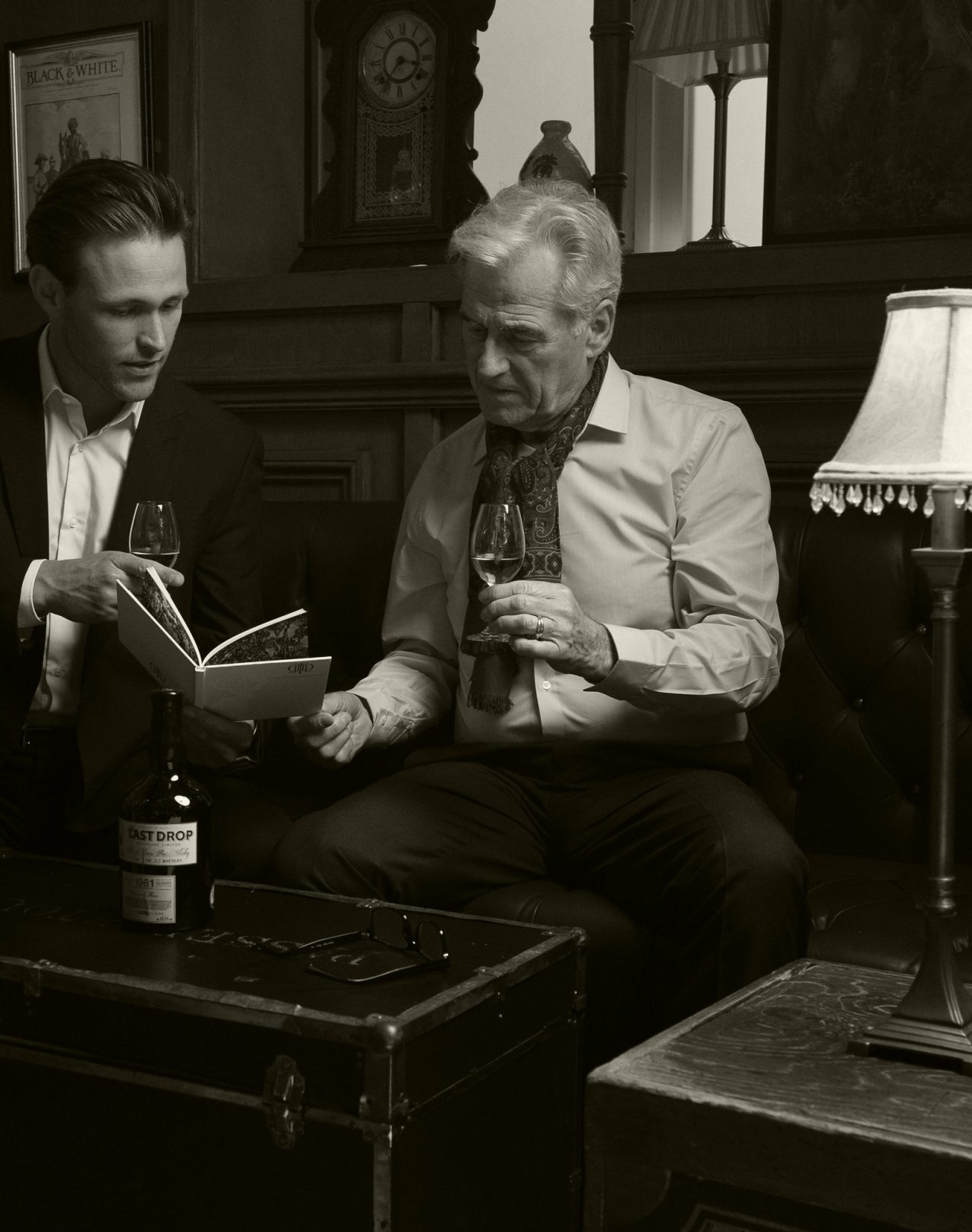 Black and white two men drinking Last Drop