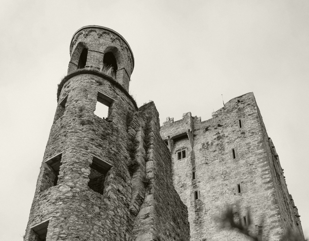 Black and white close up of tower of an Irish castle