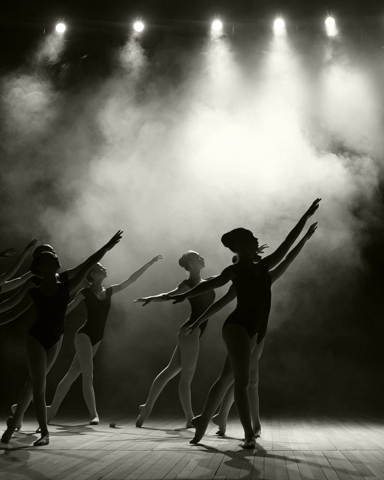 Black and white picture of six young ladies during a ballet recital
