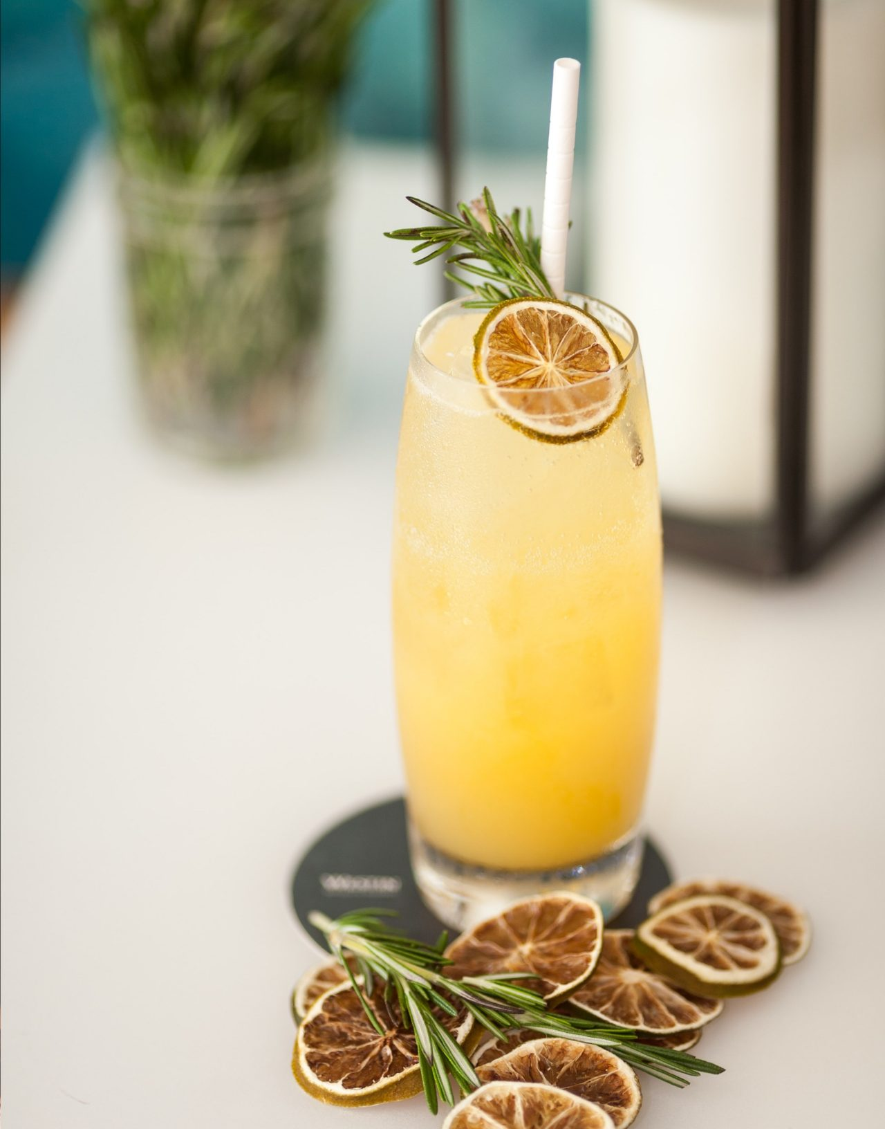 Yellow fruity cocktail with dried lemon garnish