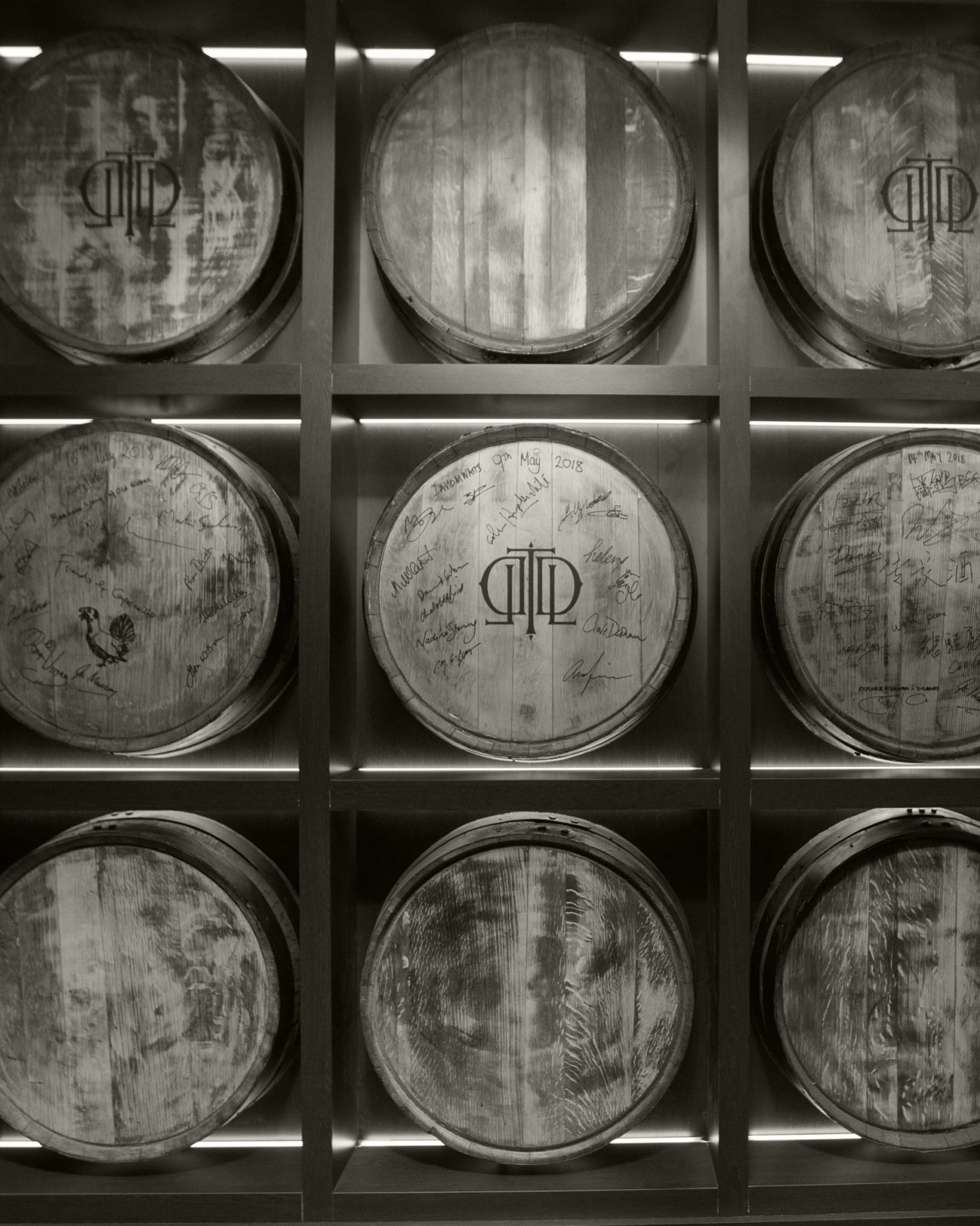 Black and white wall of Last Drop barrels