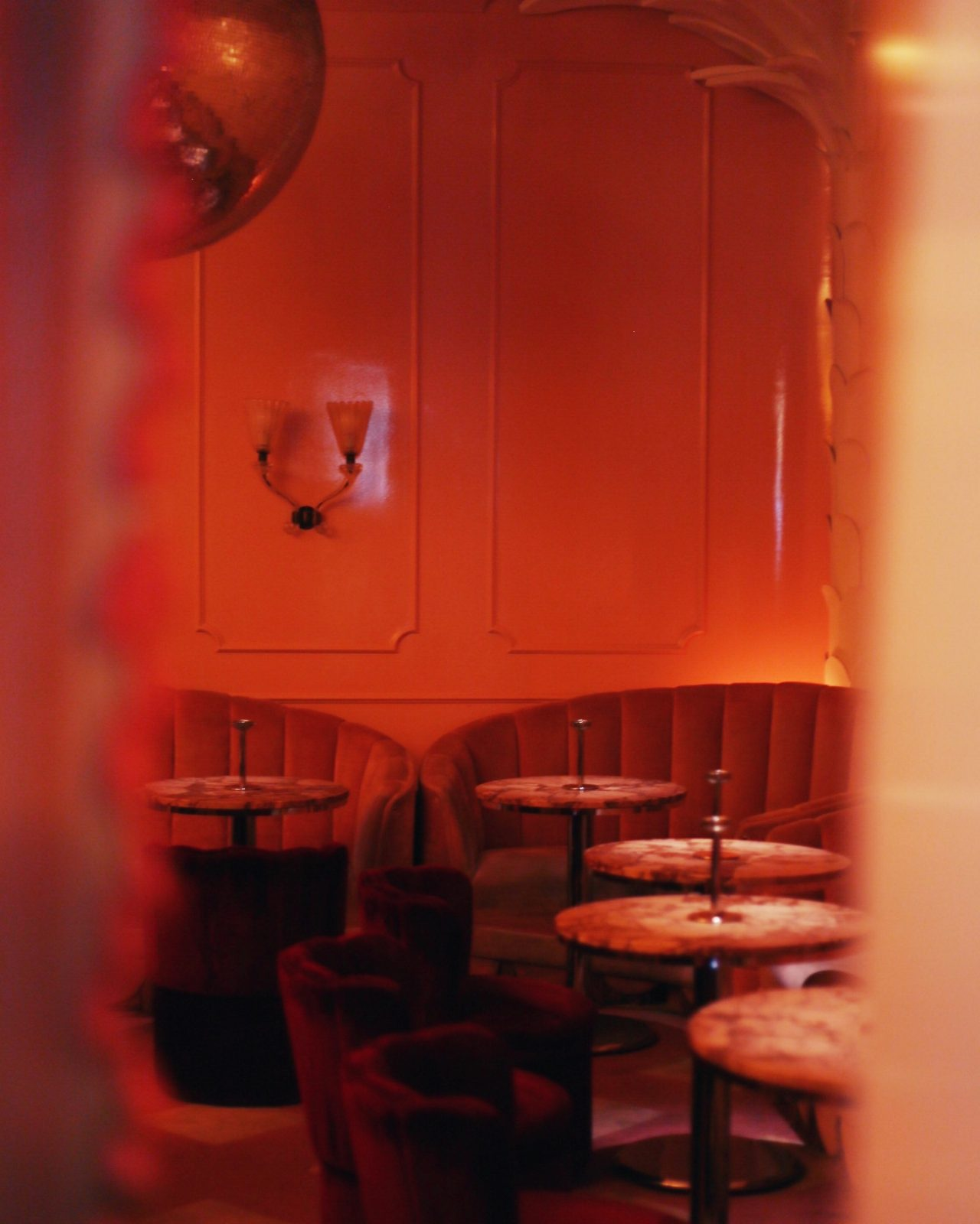 Inside of a Montreal speakeasy with a red hue