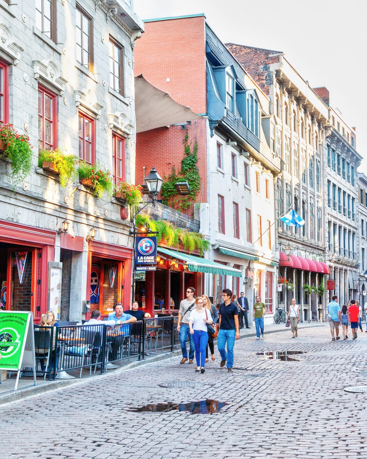 People walking on cobblestone street in Montreal in daytime