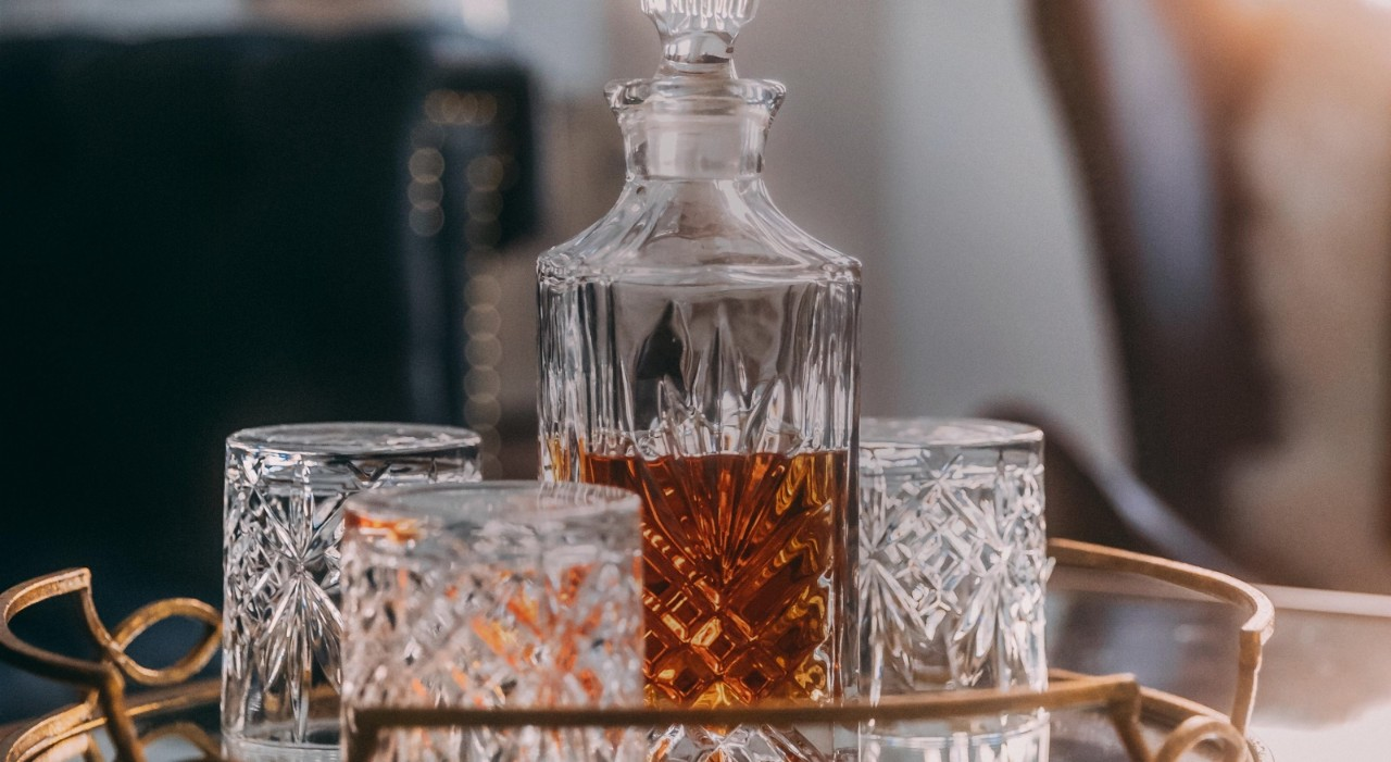 Whiskey in glass decanter with matching glasses